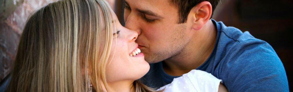 husband kissing wife on her cheek